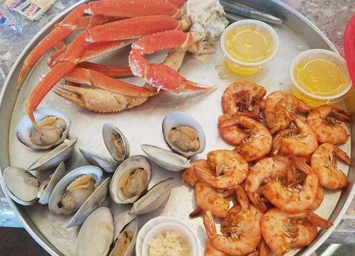 seafood, crab legs, steamed shrimp, clams