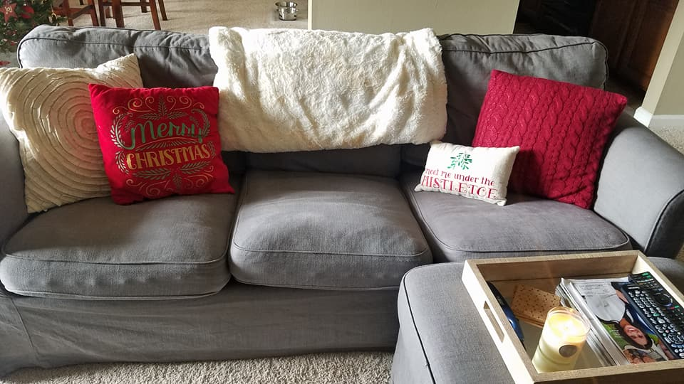 christmas pillows, grey couch, ottoman table